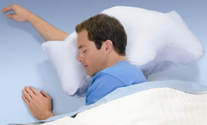 a man sleeping on a stop snoring pillow